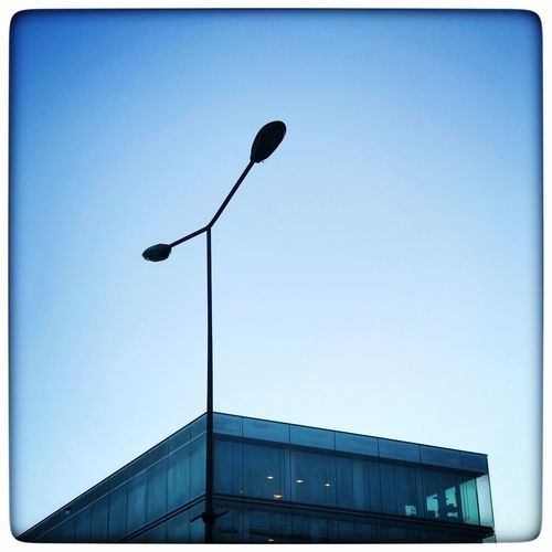 Urban graphics Low Angle View Street Light Architecture No People Built Structure Outdoors Day Blue Building Exterior Clear Sky Technology Sky The Graphic City Visual Creativity