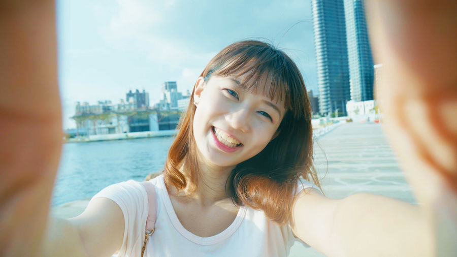 Architecture Beautiful Woman Building Exterior Built Structure City Cityscape Close-up Day Front View Happiness Headshot Outdoors People Portrait Real People Selfie Sky Skyscraper Smiling Togetherness Water Young Adult Young Women