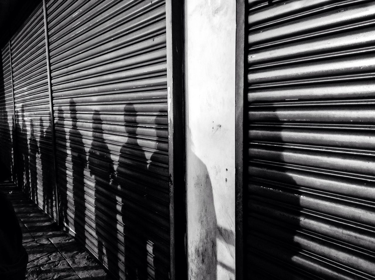 Shadow of people on shutter