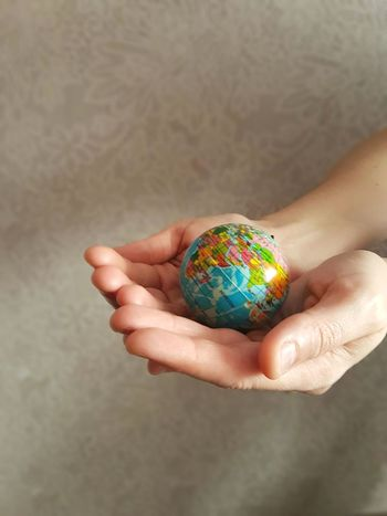 EyeEm Selects Human Body Part Human Hand Holding One Person Protection Adult People Close-up Indoors  Fragility Planet Earth Adults Only One Woman Only Nature Day Globe Hands Round Peace ✌ Earth 🌏 Is Beautiful Earth Earth_Collections