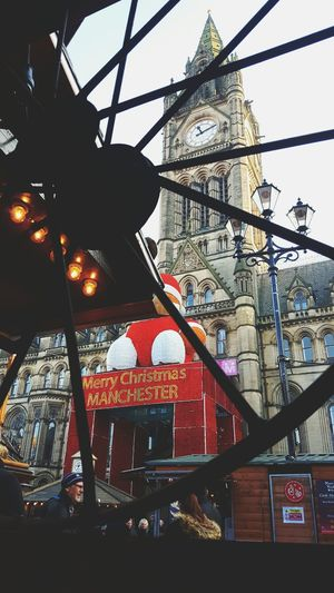 This Is Christmas day 20. Christmas Markets Christmas Market Manchester Morning Father Christmas Looking Through Clock Face Love Not Hate Solidarity Standing With Berlin