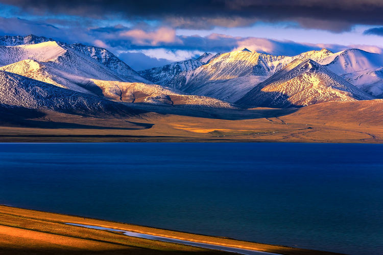 Amazing Lake Sunrise in Tibet Beauty In Nature Cloud - Sky Cold Temperature Day Lake Landscape Mountain Mountain Range Namtsolake Nature No People Outdoors Scenics Sky Snow Snowcapped Mountain Sunrise Tibet Tranquil Scene Tranquility Travel Destinations Water Winter