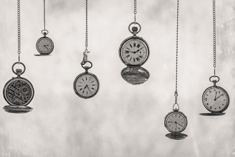 Close-up of pocket watches hanging side by side