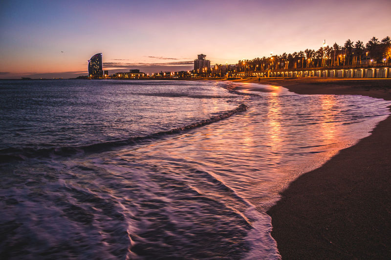 Sunset at the beach in Barcelona Architecture Beach Beauty In Nature Building Exterior Built Structure City Cityscape Day Nature No People Outdoors Sand Scenics Sea Sky Skyscraper Sunset Travel Destinations Urban Skyline Water Waterfront