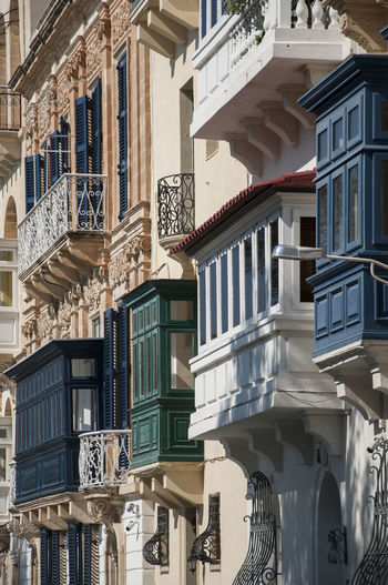 bay windows and balconies in Valletta British Façade Malta Architecture Balcony Bay Window Building Building Exterior Built Structure City Day House Low Angle View No People Ornate Design Outdoors Railing Residential District Shadow Sunlight Travel Destinations Valletta Window