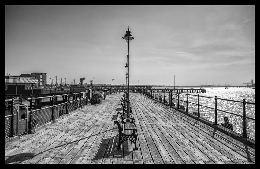 Harwich Half Penny Pier, Essex, England Architecture Black And White Boardwalk Building Exterior Built Structure Coast Day Essence Of Summer Essex Harwich Monochrome Outdoors Pier Railing Seascape Sky Sunset Travel Destinations Wood