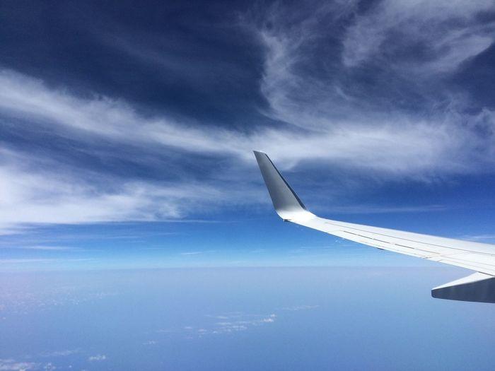 Plane Wingtip Against Sky
