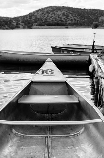 Beauty In Nature Black And White Black And White Collection  Boat Boats Calm Day Lake Mountain Mountain Range Nature No People Non-urban Scene Outdoors Rippled Scenics Sky Tranquil Scene Tranquility Water Hidden Gems  Miles Away