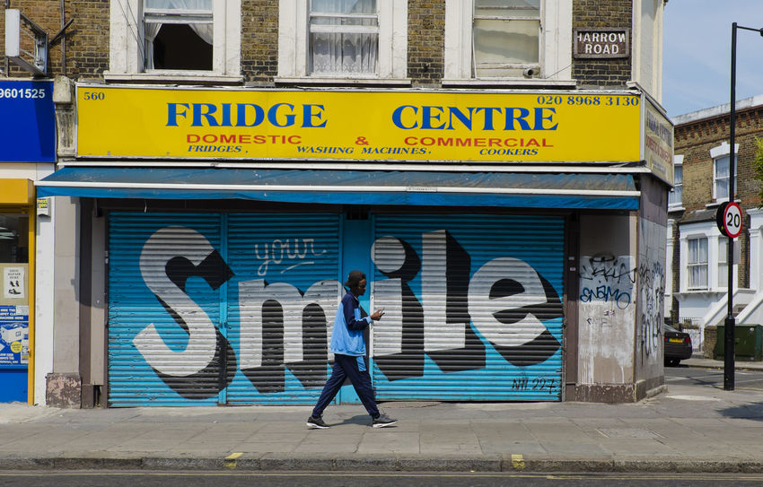Shop closed in Harrow Road on 1st of July 2018 in London, United Kingdom. Nearly 650 shops and restaurants have shut since the start of 2018 or are at risk of closure. (photo by Lorenzo Grifantini) Building Exterior Business Finance And Industry Closure Footpath Graffiti Men Outdoors Smile Street Tax