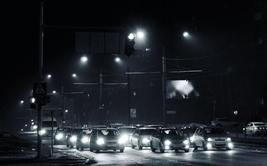 Cars Moving On City Street At Night