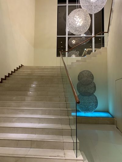 Low angle view of illuminated lamp on staircase at home