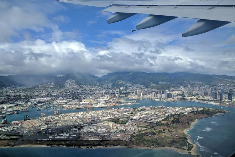 aerial view of sand island and downtown honolulu Flying Aerial View Mobile Photography Airplane Visiting My Home Town Honolulu  Going Home Clouds And Sky Urban Skyline Mid-air Oahu Visiting My City Landscape Aircraft Wing Scenics Outdoor Photography Mountains And Sky Neighborhood Map Let's Go. Together.