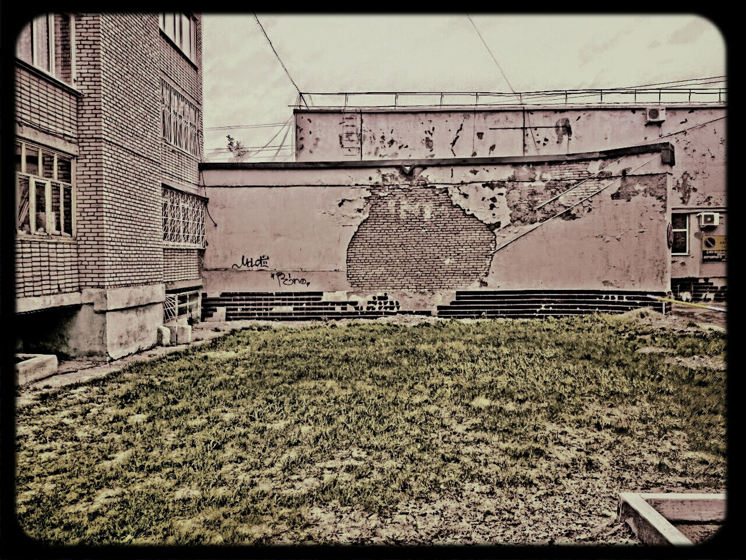 transfer print, auto post production filter, building exterior, built structure, architecture, abandoned, day, transportation, outdoors, no people, house, wall - building feature, power line, clear sky, graffiti, plant, old, grass, obsolete, railroad track