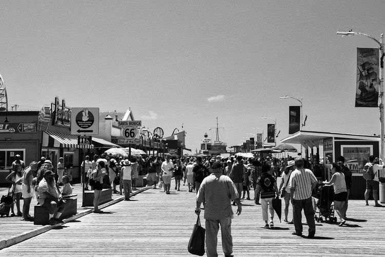 Scene at Santa Monica Pier Black And White Blackandwhite Crowd Day End Grain Grainy Images Large Group Of People Pier Route 66 Santa Monica Pier The Essence Of Summer People Together People And Places Monochrome Photography People