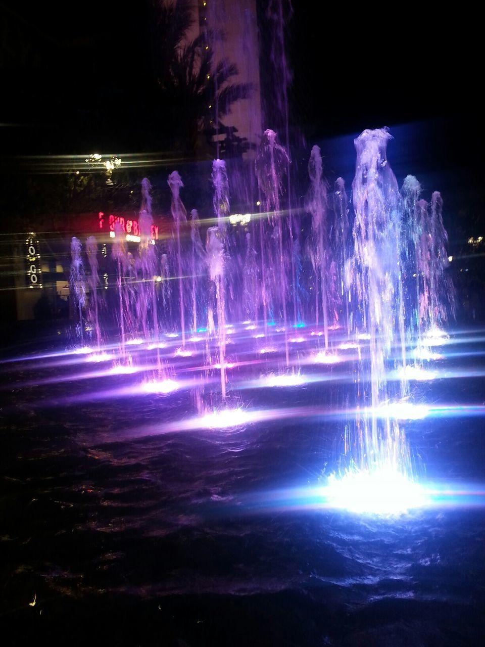 illuminated, night, long exposure, motion, no people, water, outdoors, lightning