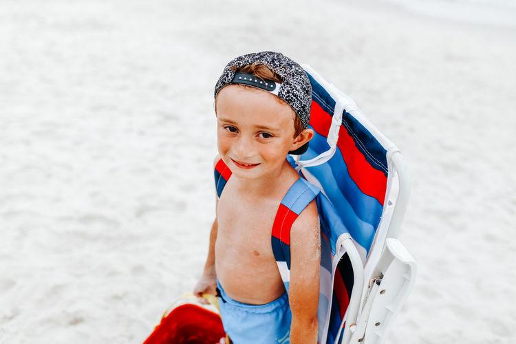 Portrait of happy boy on beach