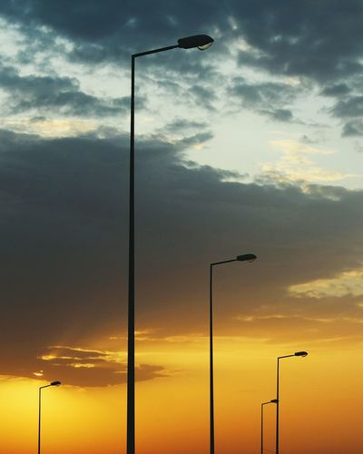 Streetphotography Sunset Sunset Silhouettes Clouds And Sky Lamppost Urban Geometry