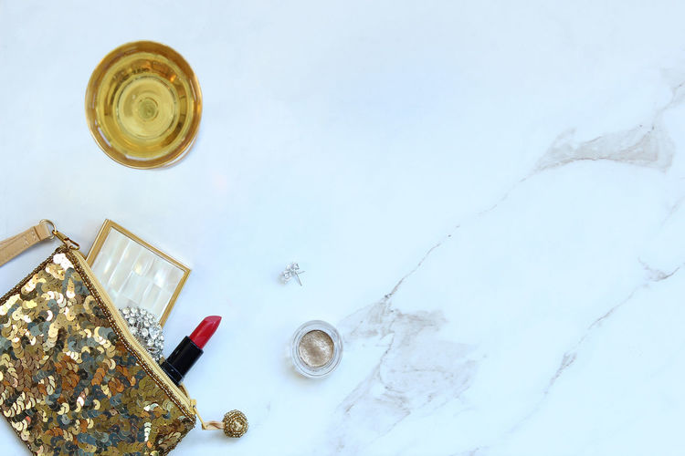 High Angle View Of Various Objects On White Marble