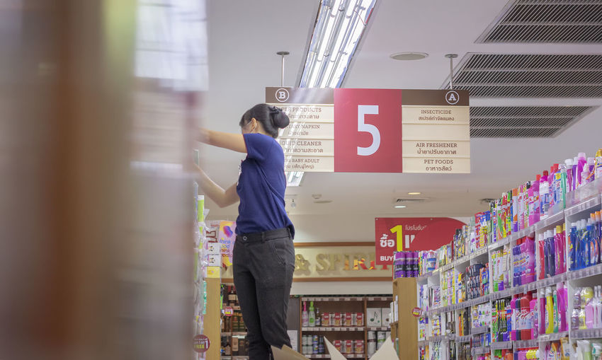 Rear view of woman standing in store