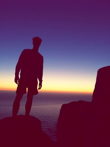 Silhouette Sea Sunset Nature Water Horizon Over Water Beauty In Nature Scenics Tranquility Lionshead Lionsheadpeak Travel Cape Town Tranquil Scene Standing Beach Full Length Men Sky One Person Outdoors Clear Sky Vacations