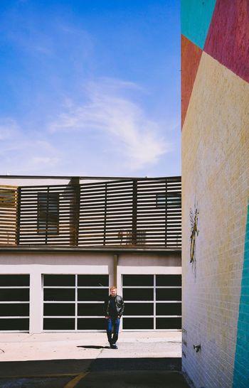 Full length of man on building wall against sky