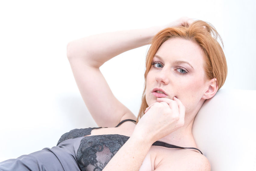 Beautiful Woman Attractive Beautiful Woman Caucasian Charming Clean Close-up Day Emotional Human Hand Indoors  Leisure Activity Lifestyles Lingerie One Person People Portrait Real People Relaxed Seductive White Background Young Adult Young Women