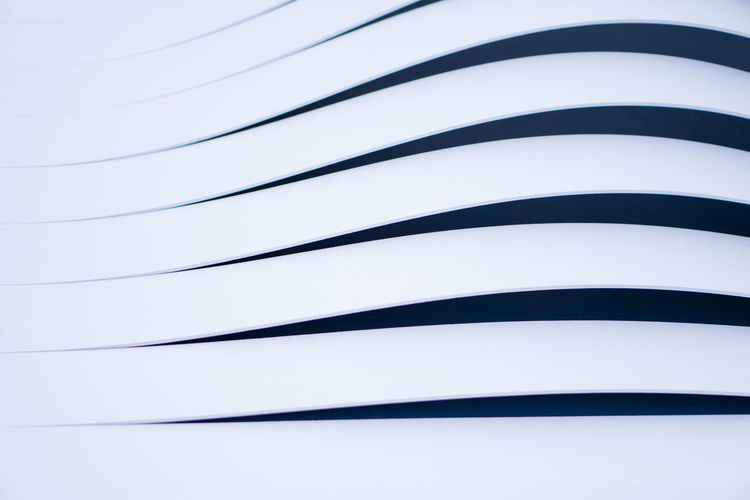 Full Frame Of Curved Lines On Modern Building