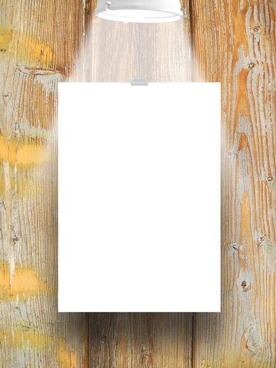 Single hanged paper sheet with lamp on weathered wooden board background A4 Format Dimension Bad Condition Blue Clip Deterioration Empty Frame Lamp Light Obsolete Old Paper Rectangular Frame Scratched And Cracked Wood Shades Of Grey Single Object Studio Shot Transfer Print Vertical Paper Sheet White Wooden Board Background Yellow