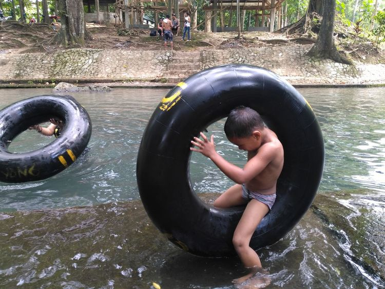 Outdoors Real People Water Elephant One Person Day People Human Body Part Human Hand Adult Water Park Eyeem Philippines Choosephilippines Travel Photography Itsmorefuninthephilippines The Street Photographer - 2017 EyeEm Awards