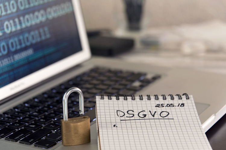 German General Data Protection Regulation DSGVO new law in 2018 - checklist, notepad on keyboard with padlock and binary data on screen Business Desktop Security Binary Data Checklist Computer Data Data Protection Datenchutz Dsgvo Europe Gdpr Handwriting  High Angle View Information Internet Keyboard Laptop Law Legal Notepd Padlock Privacy Protection Regulator