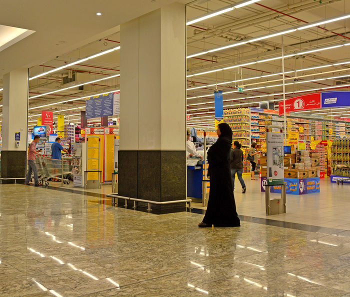 Dubai Supermarket Emerates Dubai Shopping Mall Food For Sale Lighting Reflections Local Woman Shiny Floor Stacked Shelves