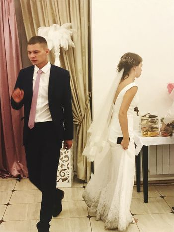 Bride Wedding Dress Wedding Life Events Standing Fashion Celebration Event Indoors  Fitting Room Well-dressed Full Length Celebration Real People Groom Two People Happiness Young Adult Togetherness Bridal Shop Young Women