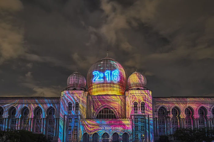 PUTRAJAYA - DECEMBER 31: A colorful projection mapping show with the background view of Palace Of Justice on December 31, 2017 in Putrajaya. Landscape_Collection Arch Architectural Column Architecture Building Exterior Built Structure Cloud - Sky Dome Illuminated Landscape Landscape_photography Multi Colored Night No People Outdoors Projection Mapping Projection Screen Sky Travel Destinations