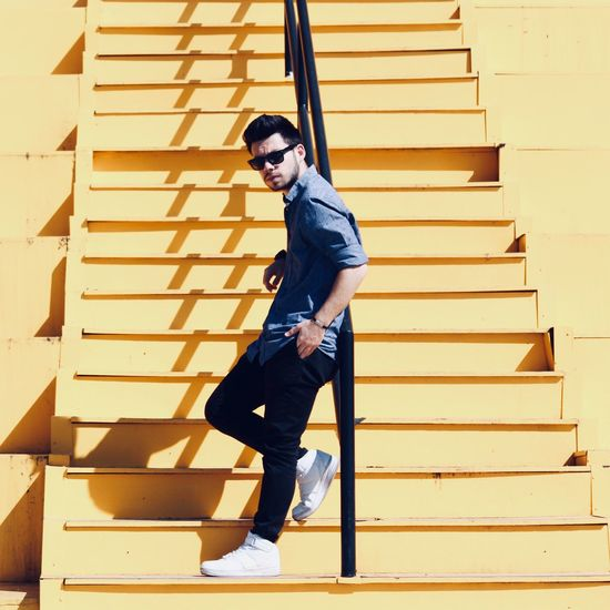 Full length of young man on staircase