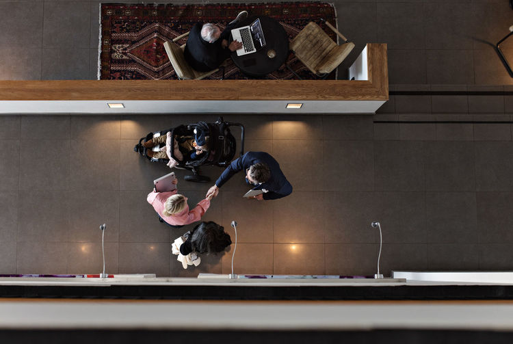 High angle view of people photographing in kitchen