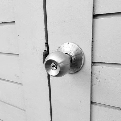 Close-up of door handle on wall