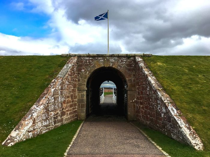The imposing entrance of Fort George near Inverness, Highlands of Scotland EyeEm Best Shots Uk Scotland Highlands Inverness Fort George Fort Cloud - Sky Sky Day Architecture Built Structure Flag The Way Forward Outdoors Grass Nature