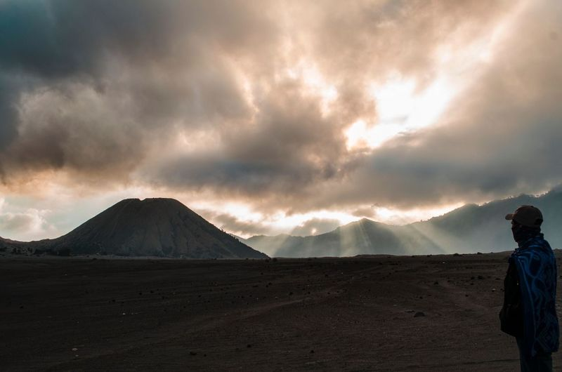 traveler sees the mountain scenery. Travel Travelphotography Bromo Tengger Semeru National Park Amazing Scenery EyeEm Selects Bromo Mountain Bromo Mountain Sky Cloud - Sky Beauty In Nature Scenics - Nature Environment Landscape Land Geology Nature Travel Destinations Non-urban Scene Desert Tranquil Scene Volcano Cloudscape Outdoors Mountain Range Travel Power In Nature EyeEmNewHere