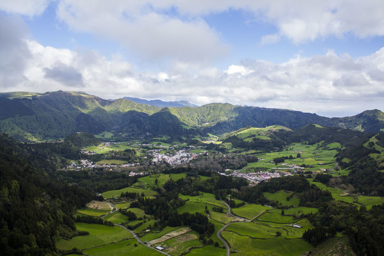 Azores landscape Agriculture Azores Field Green Color Beauty In Nature Cloud - Sky Environment Green Color Hill Idyllic Island Land Landscape Mountain Mountain Range Nature No People Non-urban Scene Outdoors Scenics - Nature Tranquil Scene Tranquility Valley Vibrant Village