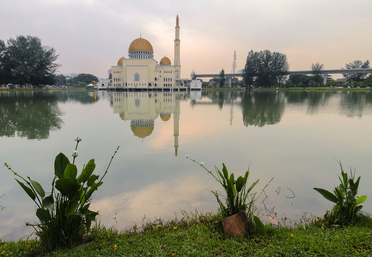 View and reflection of Assalam Mosque with blue skies and white clouds. Architecture Building Exterior Built Structure Dome Faith Lake And Ponds Outdoors Place Of Worship Reflection Religion See Double Sunrise Travel Travel Destinations Water