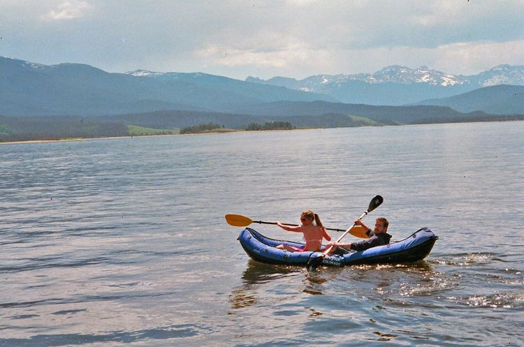 Been There. Togetherness Two People Heterosexual Couple Bonding Leisure Activity Mountain Enjoyment Getting Away From It All Adventure Love Lake Young Adult Men Young Women Fun Cloud - Sky Vacations Adult Day Young Men Rocky Mountain National Park Rocky Mountains Raft Rowing