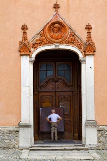 Rear view of man standing by door