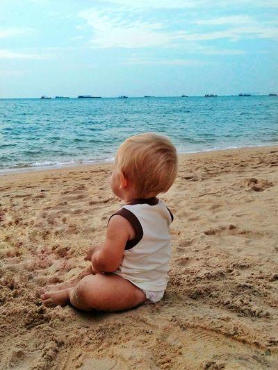 Child on sand at beach