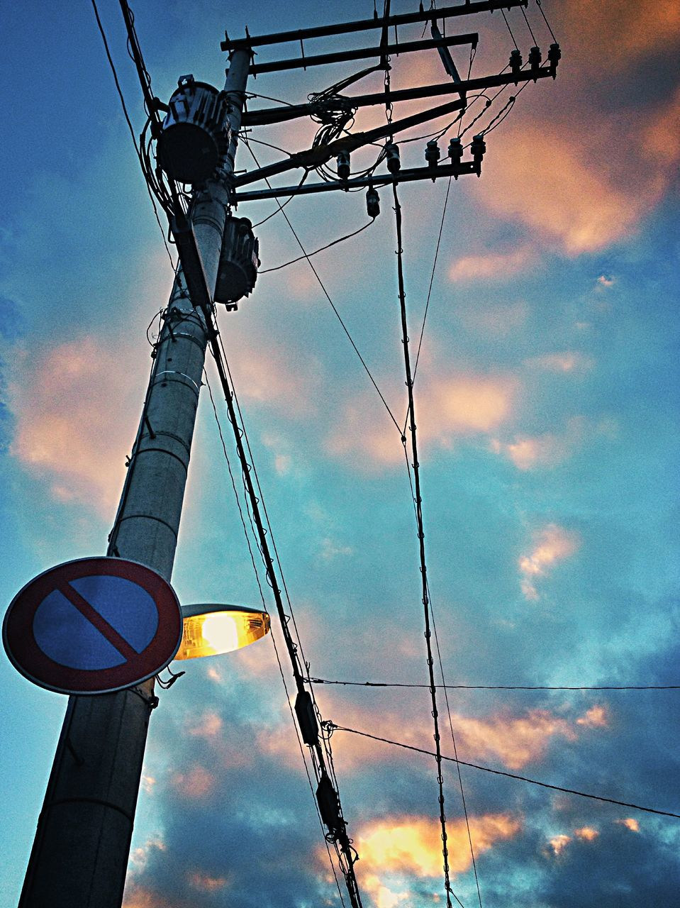 low angle view, sky, cloud - sky, cable, connection, outdoors, no people, electricity, technology, day