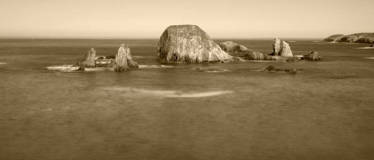View of Represas beach in Tapia de Casariego, Asturias - Spain Asturias Retro SPAIN Tapia Tapia De Casariego Travel Beach Beauty In Nature Black And White Horizon Idyllic Land Landscape Nature Outdoors Represas Rock Rock - Object Scenics - Nature Sea Sea View Sepia Summer Vintage Water