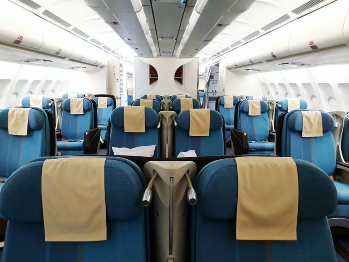 Cabin Airplane Commercial Airplane Airplane Seat City Vehicle Seat Subway Train Journey Blue Public Transportation Travel