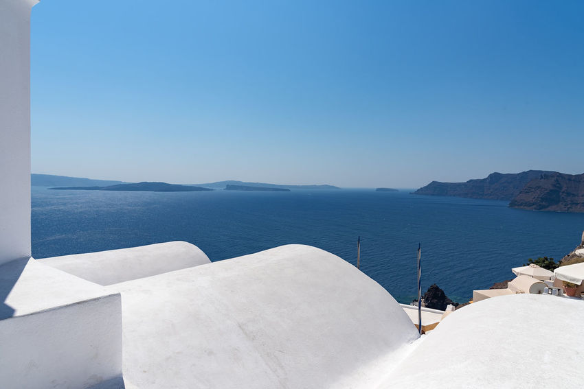 Oia village - Santorini Cyclades Island - Aegean sea - Greece Greece Santorini Oia Cyclades Island Mediterranean  Volcano Caldera Village Whitewashed Aegean Water Sea Scenics - Nature Beauty In Nature Copy Space Tranquil Scene Tranquility Clear Sky Mountain Nature Idyllic Sunlight Land White Color