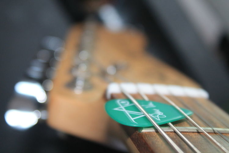 Close-up Of Guitar With Pick