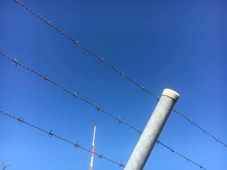 Low Angle View Blue Clear Sky No People Day Outdoors Built Structure Building Exterior Architecture Technology Nature Barbed Wire Sky Politics Politics And Government System Kalter Krieg Good Bye Germany War Cold War Against Destroy Wall