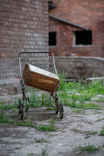 Old antique baby City Abandoned Places Antique Farmhouse Poland Ruins Abandoned Abandoned Buildings Abandoned City Absence Architecture Baby Carriage Brick Brick Wall Building Building Exterior Built Structure Carriage Day Focus On Foreground Footpath Mode Of Transportation No People Old Outdoors Plant Ruin Shopping Cart Transportation Wall Wall - Building Feature Wheel